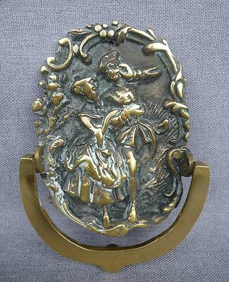 Antique french door knocker mid-1900's or before made of brass romantic scene