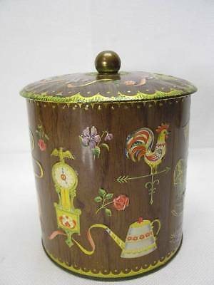 Vintage metal CANISTER  with raised relief designed by Damer and made in England