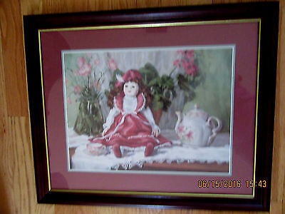 Home Interior Doll sitting on the cabinet with vase w flowers & Teapot