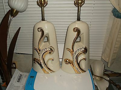Pair of Retro mid century modern white and gold need wax shade lamps