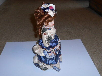 The Broadway Collection 14'' High fire Bisque Porcelain Doll
