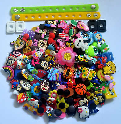 100pcs different  shoe charms  + 2pcs Wristbands+4pcs Shoe Lace Adapter