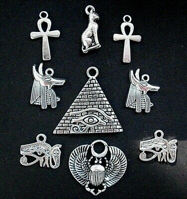 9 Assorted Ancient Egyptian Charms  Scarab Isis Bas Cat Eye of Horus Silver Tone