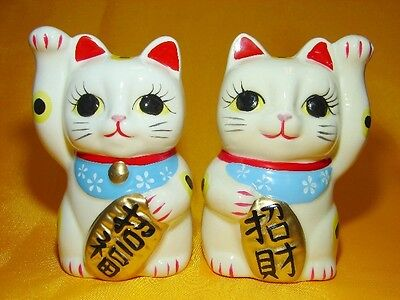 Pair of White Porcelain Lucky Cat Statues