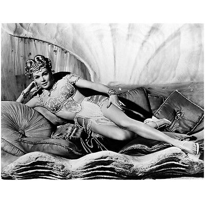Lana Turner Laying on Pillows Smiling 8 x 10 Inch Photo