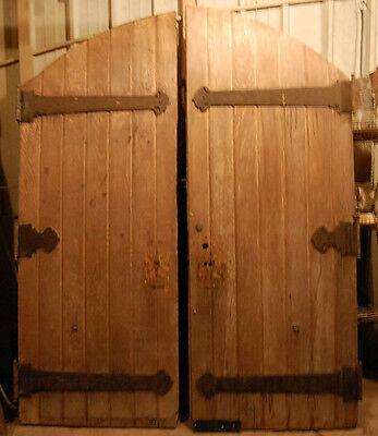 Pair of Antique Arched Top Oak Church Doors from Detroit with Original Hardware