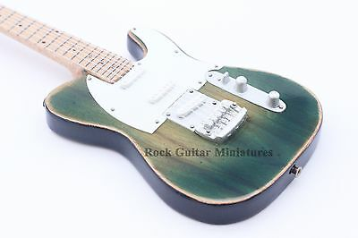 RGM667 Francis Rossi Status Quo Miniature Guitar with leather strap