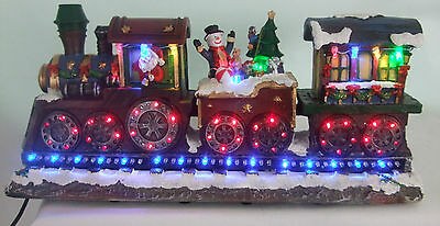 Christmas Train with rotating effect LED wheels 38cm long