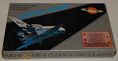 *VINTAGE SHUTTLE VOYAGE LCD HANDHELD MG-8 CALCULATOR GAME CLOCK BOX/BOXED*/watch