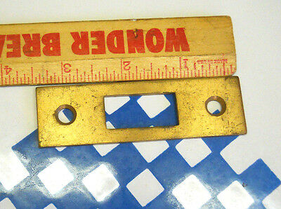 old DOOR KNOB LATCH CAST BRASS STRIKE PLATE