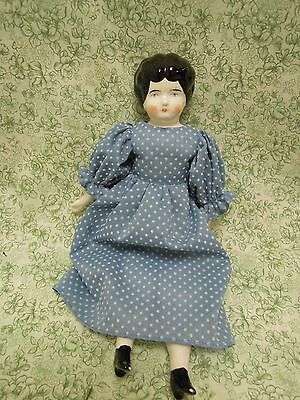China head/ porcelain/cloth doll,  10 inches tall reproduction  cp-682