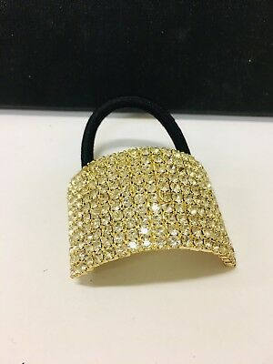 Popular elastic hair band in gold colour with crystal rhinestones