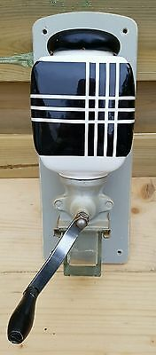 BLACK AND WHITE Wall mounted coffee grinder ca.1950