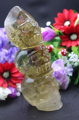 928 grams of natural quartz crystal yellow crystal in a skull to heal