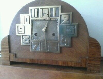 Art deco oak mantel clock made by Hamburg American clock  company  in Germany.