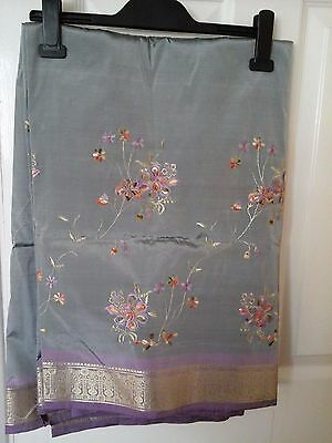 Indian floral embroidery sareeand stones on the head piece with blouse piece.