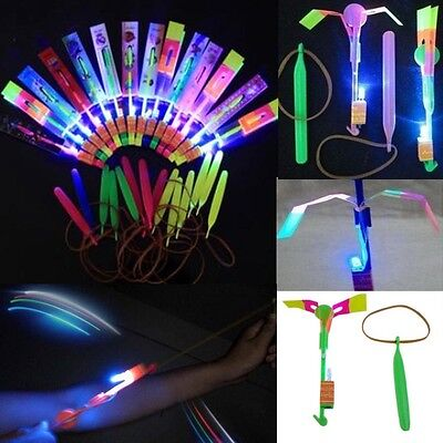 12pcs Children Helicopter Rotating Flying Toy Amazing LED Light Rocket Party Fun