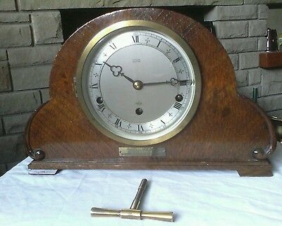 Antique mantel clock made by Elliot fattorini Bradford in oak in working.