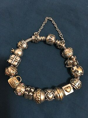 Pandora full bracelet gold and silver charms