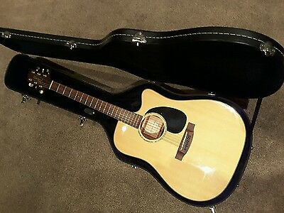 A Takamine EG340C G Series Electro Acoustic Guitar with Hard case