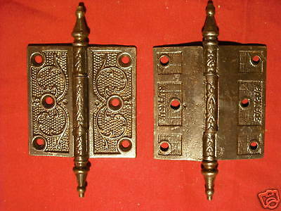 Pair of embossed steeple cap hinges