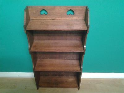 Small Arts and Crafts oak bookcase shelves pierced heart motifs