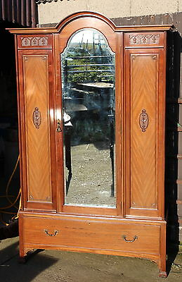 An Edwardian Carved Mahogany Mirror Fronted Wardrobe Part Suite