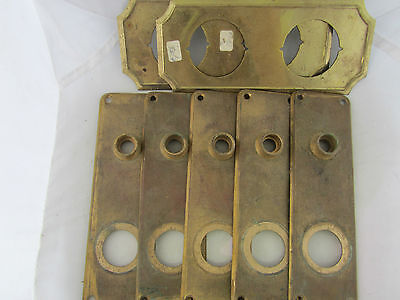 Seven Antique Brass Door Plates