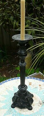 Large, heavy, antique, single stem cast iron candlestick in good condition