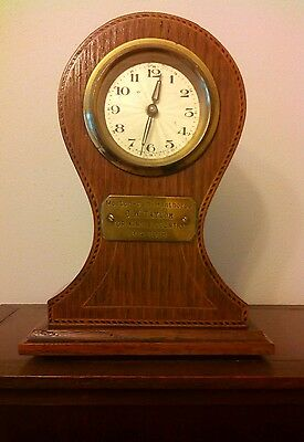 small Edwardian mahogany inlay mantel ballon clock in excellent condition.