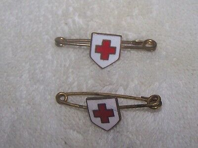 Two Red Cross   Brooches
