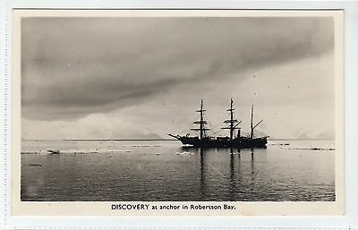 """DISCOVERY"" AT ANCHOR in ROBERTSON BAY: 1950s postcard of earlier image (C13052)"