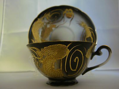 Dragonware Cup & Saucer w/Geisha girl bottom of cup,black & gold Made in Japan