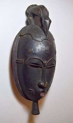 A Classic Baule African Dance mask with Avian finial, African Tribal Art