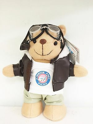 a teddy bear pilot with leather jacket and flying goggles. Bear can stand up