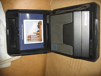 Vintage Polaroid spectra system SE camera in case with paperwork