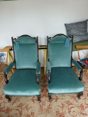 Pair of antique Edwardian armchairs traditionally reupholstered in turquoise