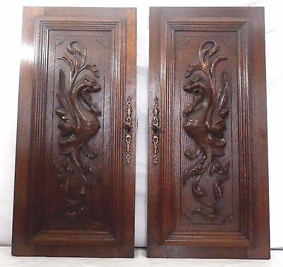Pair of Antique French Wood of oak door  panel carved chimera  of 19 th