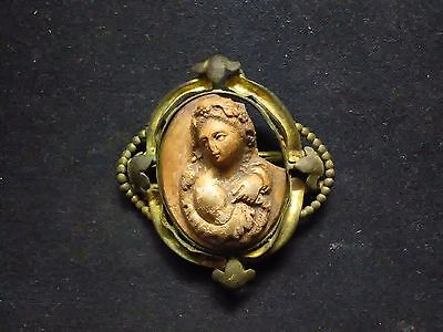 Copper alloy gold gilted antique brooch with carved cameo.