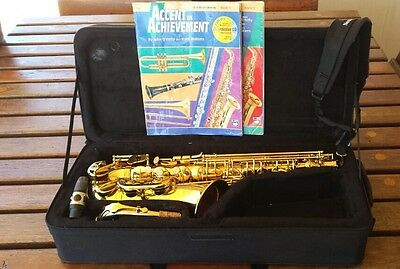 Alto Saxophone, Case, Neck Collar, Sax brush cleaner, and 2 x Music books