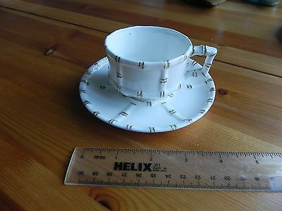 A  small Cup and Saucer made by E J D BODLEY C1880