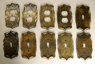 VINTAGE AMEROCK CARRIAGE HOUSE SWITCH AND OUTLET PLATE COVERS. Lot of (10)