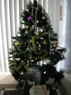 Christmas Tree 6 feet in green  and lots of branches + decorations Pick up only