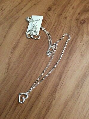 Costume jewellery, necklace and earrings, heart shaped in silver colour