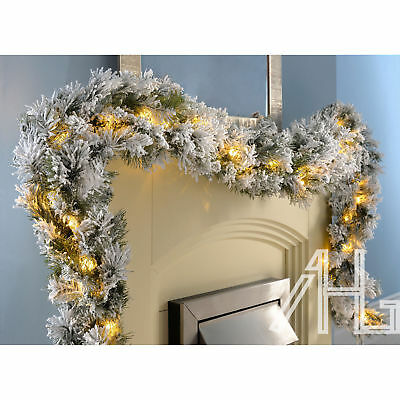Deluxe 9ft Super Thick Pre-Lit LED Snow Flocked Vancouver Pine Christmas Garland