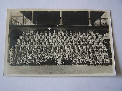 Vintage RP Postcard Large Group Soldiers in Uniform With Shield Military