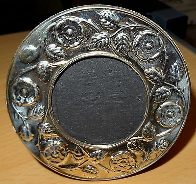 A Round Vintage Silver Stylized Floral Photo Frame.