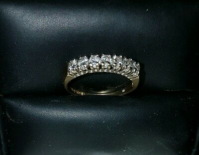 Lovely Ladies 9 Carat Gold Ring With 7 Small Diamonds Inset.