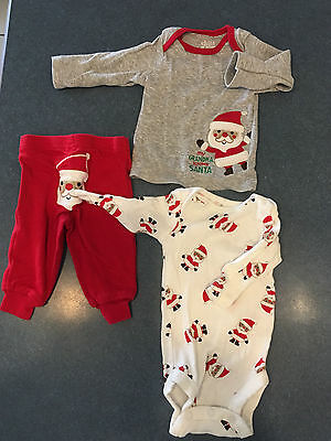 Lot of 3 pieces EUC newborn Christmas baby clothes by Carter