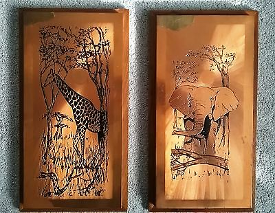 A Pair of 1970s Rhodesian Wildlife Copper Wall Plaques
